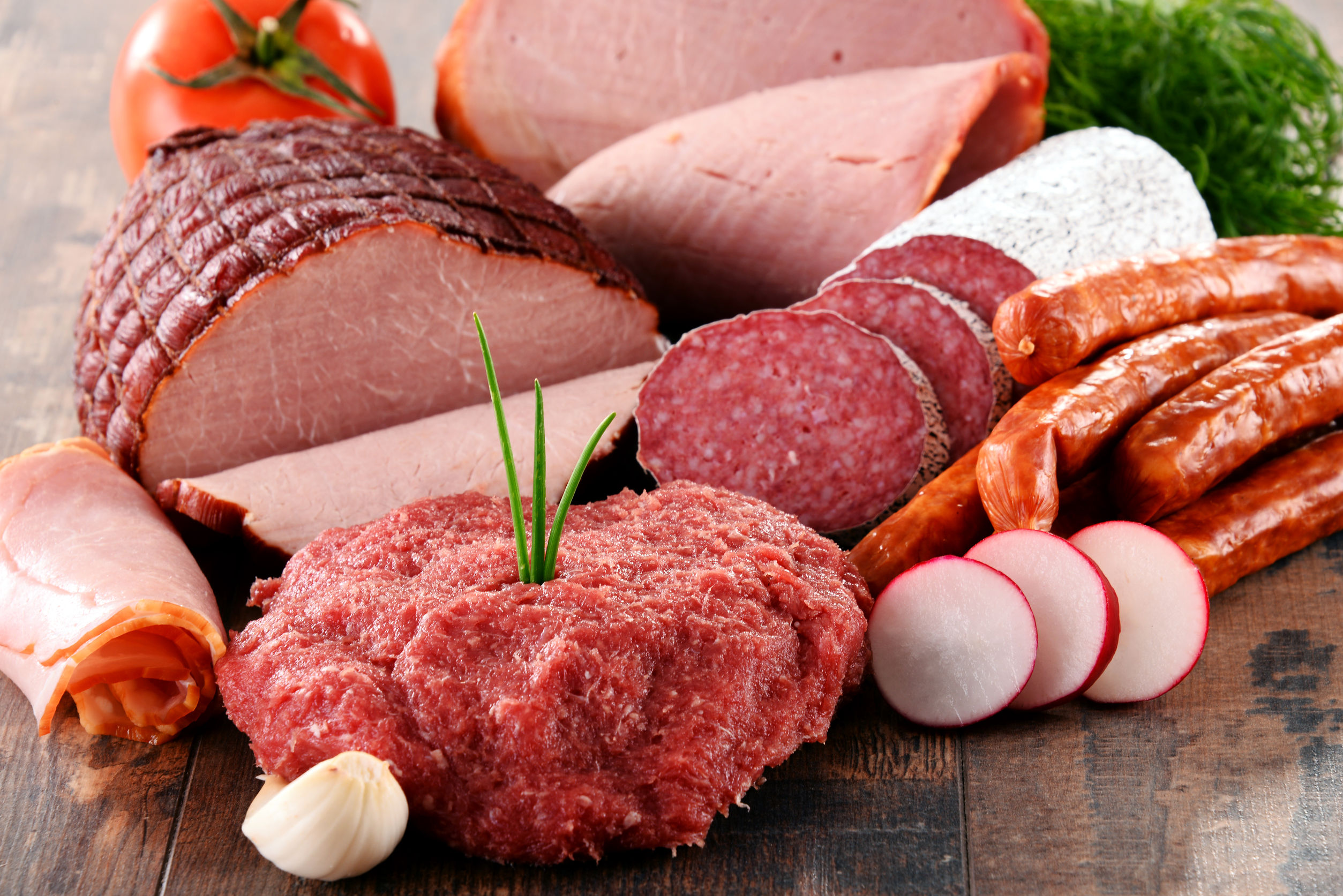 38686988 - assorted meat products including ham and sausages.